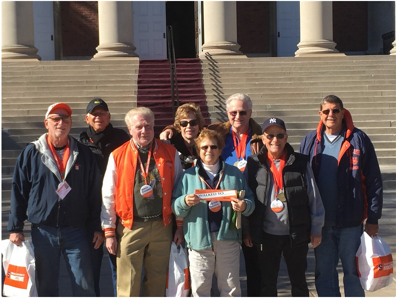 Syracuse University alumni post after walking the SU campus Monday Mile route