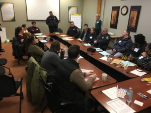 Syracuse Police Department and Peacemaking Center meet to plan the audit.